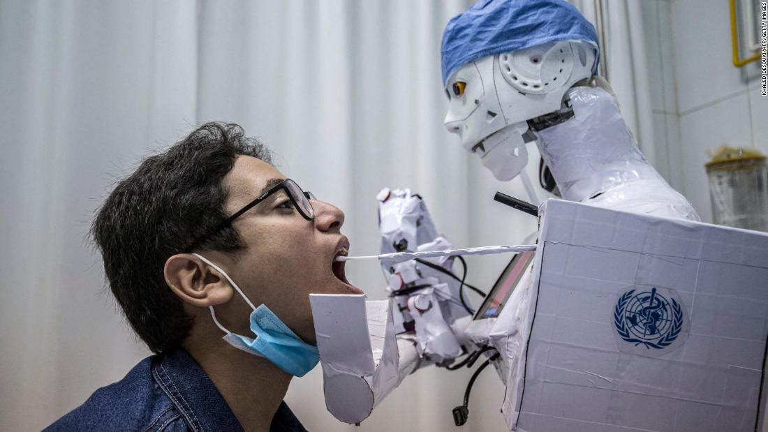 A remote-controlled robot takes a throat swab at a hospital in Tanta, Egypt, on March 20. The robot prototype is part of a project to assist physicians in testing patients for Covid-19.
