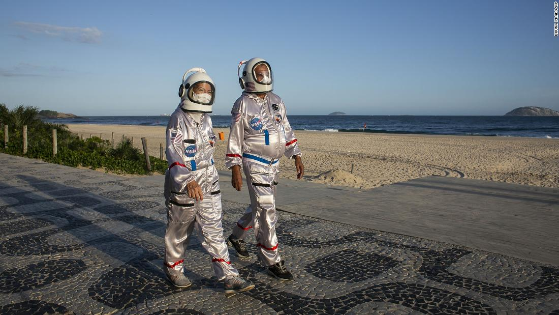 Tercio Galdino and his wife, Alicea, wear astronaut costumes to protect themselves from Covid-19 as they walk along the Ipanema Beach in Rio de Janeiro on March 20.