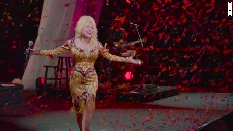"The legendary singer is shown in a scene from ""Dolly Parton: A MusicCares Tribute"" on Netflix."