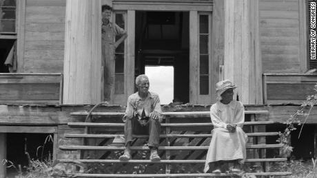 An ex-slave and his wife on the steps of a decaying plantation house in Greene County, Georgia. Many Black Southerners saw their rights gradually eroded in the late 1800s.