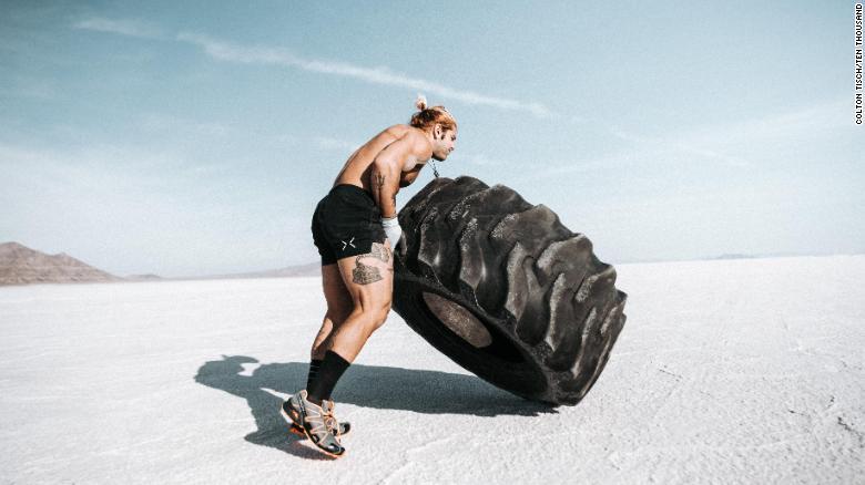 Miraglia flips a tire for a mile during his Strongman Marathon.