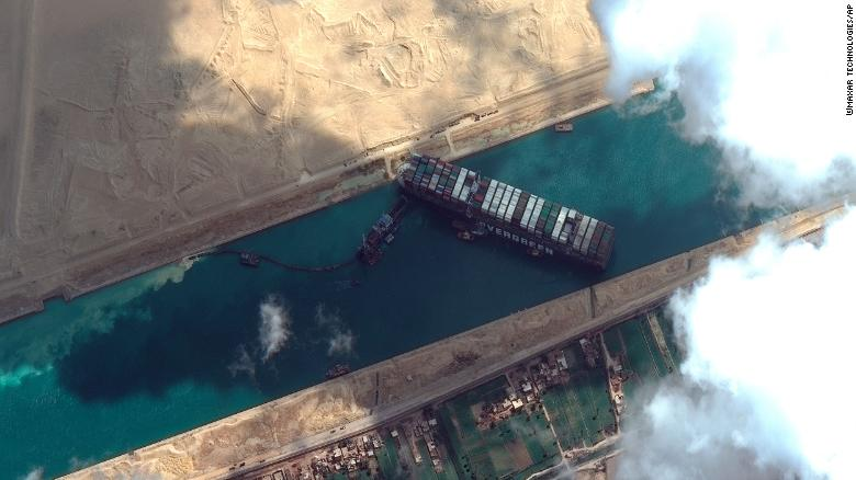 This satellite image shows the Ever Given vessel stuck in Egypt's Suez Canal on Friday, March 26. The container ship has been blocking traffic for days.
