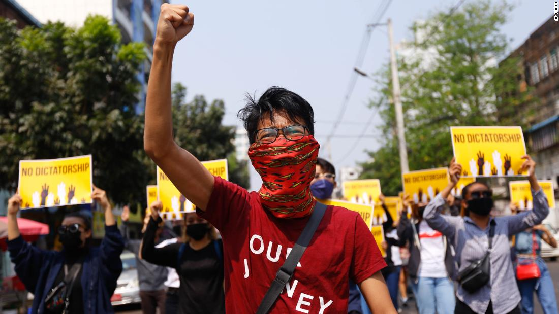 Protesters gesture during a march in Yangon on March 26.