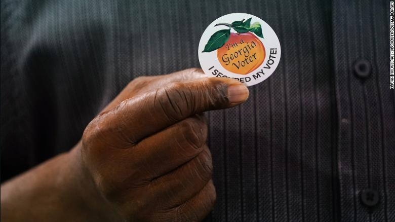 Corporate giants bow to pressure in Georgia voting law backlash