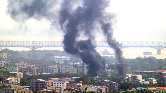 Smoke rises over Yangon's Thaketa Township on March 27.