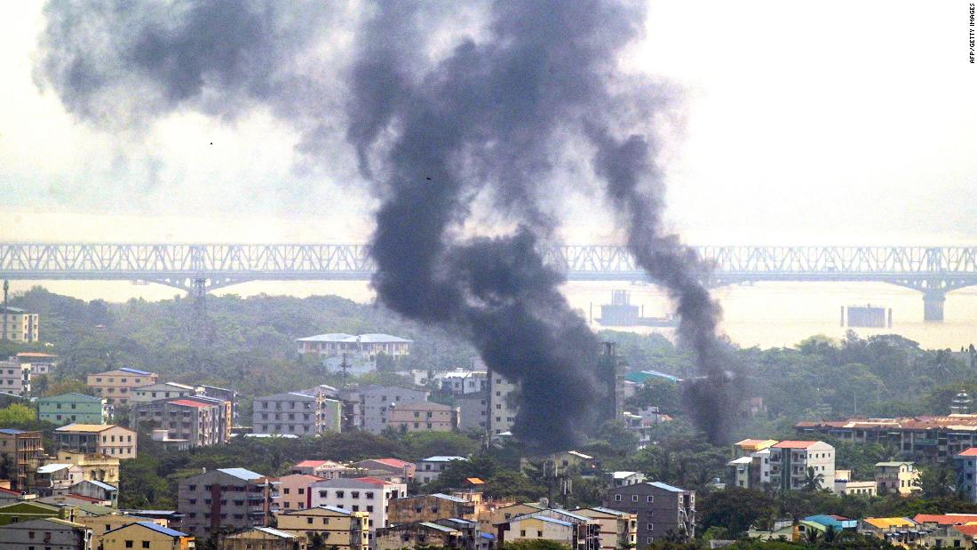 Smoke rises over Yangon's Thaketa Township on March 27.