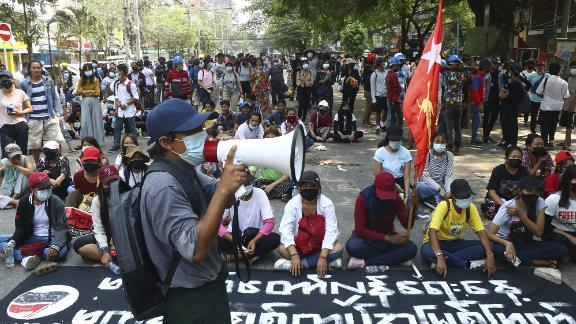 Protesters occupy a street during a rally in Yangon on March 27.