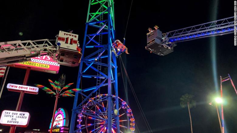 Two teens were suspended for hours on a broken amusement park ride in Florida