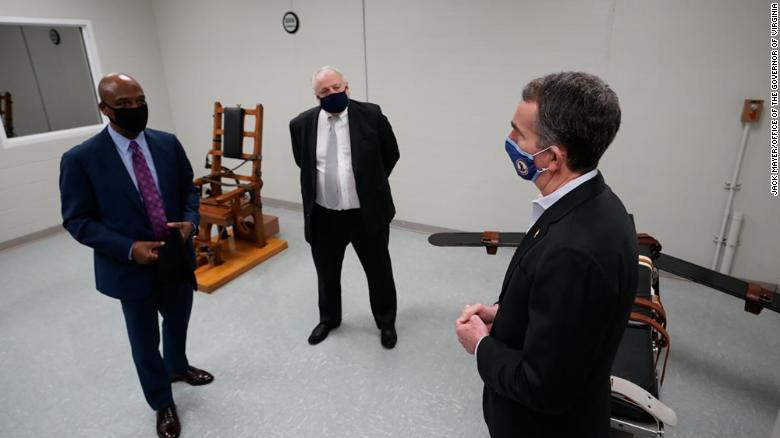 Gov. Ralph Northam, right, tours Greensville Correctional Center in Jarratt, Virginia, on March 24, 2021.