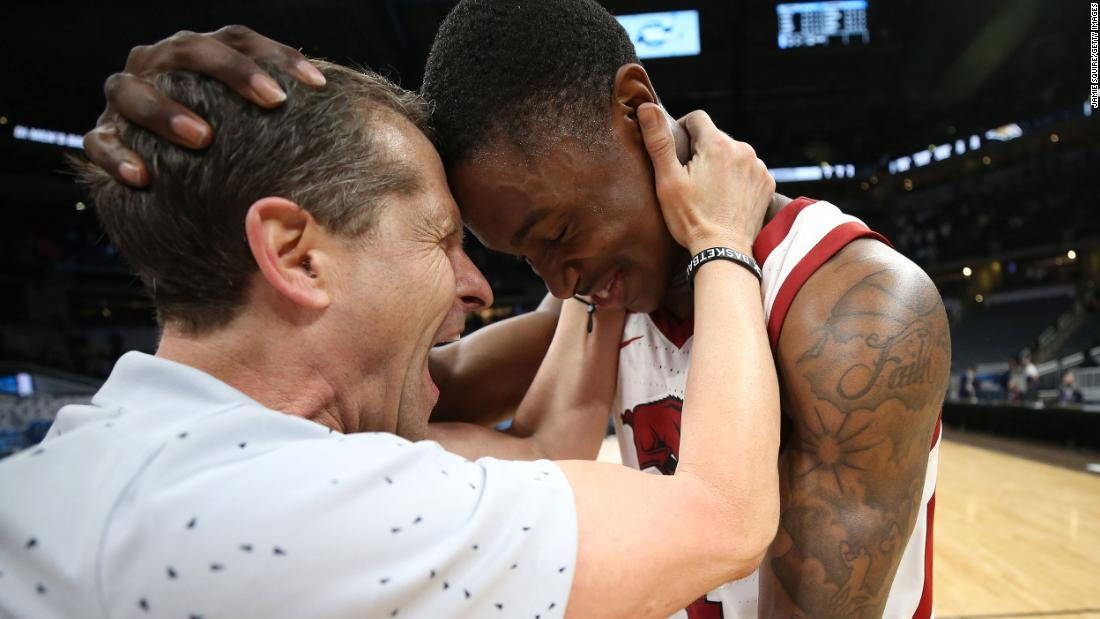 Arkansas head coach Eric Musselman celebrates with Davonte Davis after their Sweet Sixteen victory over Oral Roberts on Saturday. Davis hit the game-winning shot in the 72-70 victory.