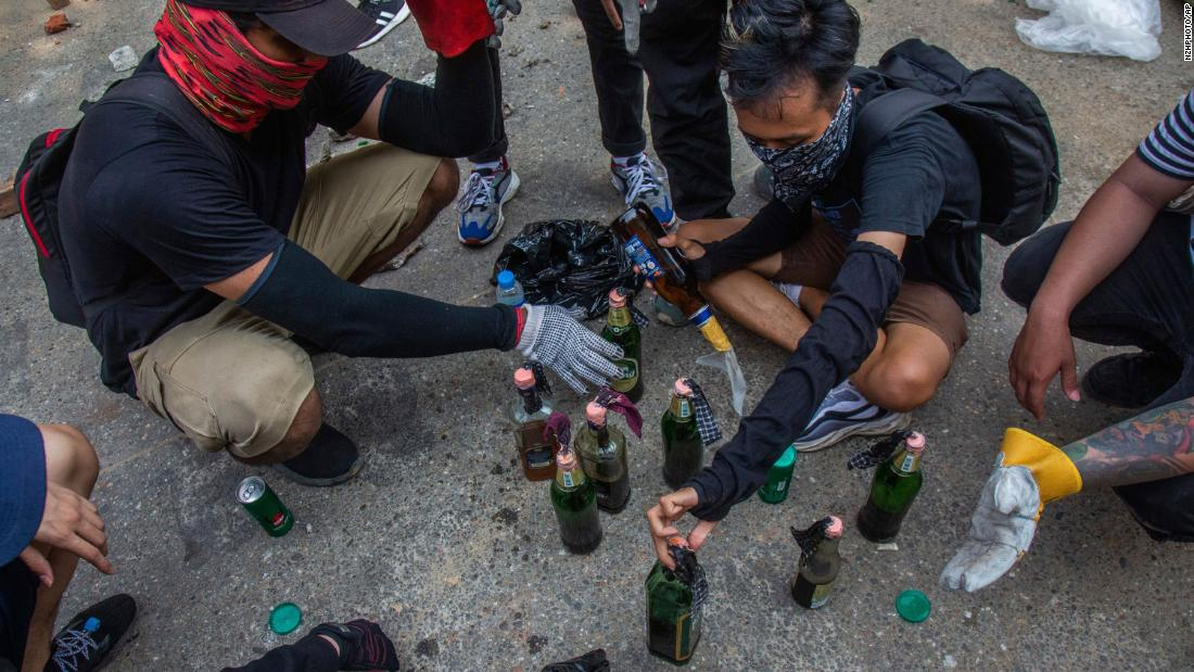Protesters make incendiary devices during an anti-coup rally in Yangon.
