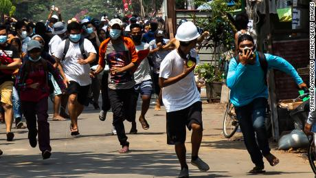 Protesters are seein running from security forces on Saturday in Yangon, Myanmar.