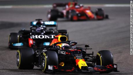 Max Verstappen driving the (33) Red Bull Racing RB16B Honda leads Lewis Hamilton during the F1 Grand Prix of Bahrain at Bahrain International Circuit on March 28, 2021.