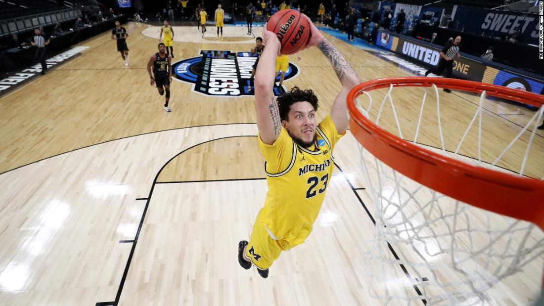 Michigan's Brandon Johns Jr. throws down a dunk during a Sweet Sixteen win against Florida State on Sunday.
