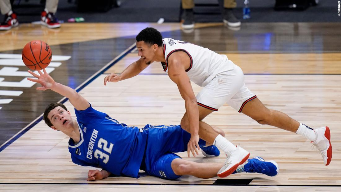 Creighton center Ryan Kalkbrenner, left, and Gonzaga guard Jalen Suggs reach for a loose ball on Sunday.