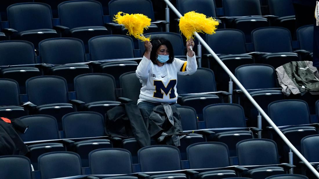 A Michigan fan cheers on her team during the game against Florida State on Sunday.