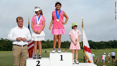 Pano stands atop the podium after winning the Regional Finals Girls 7-9 section of the Drive, Chip and Putt competition.