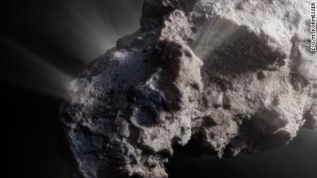 Концепція цього художника ілюструє, як може виглядати поверхня комети.