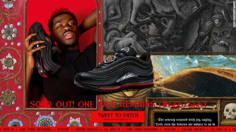 A screen shot of Satanshoes.com shows Lil Nas X holding one of the modified shoes.