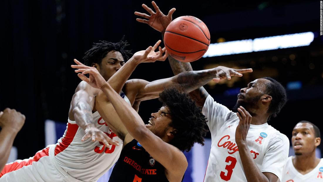 Oregon State guard Ethan Thompson, center, is fouled during the first half of the game against Houston.