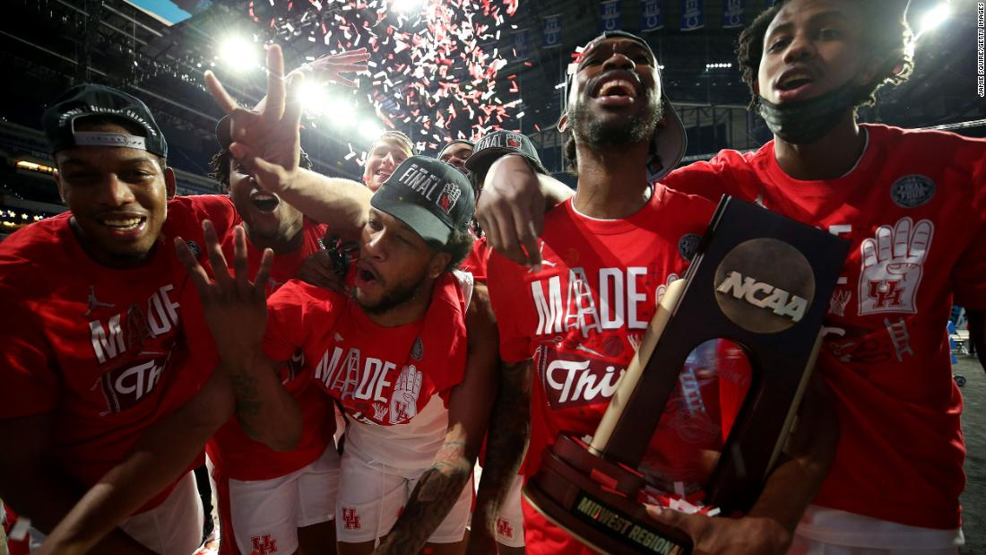 The Houston Cougars celebrate after defeating Oregon State 67-61 in the Elite Eight on Monday. Houston will play in the Final Four for the first time since 1984.