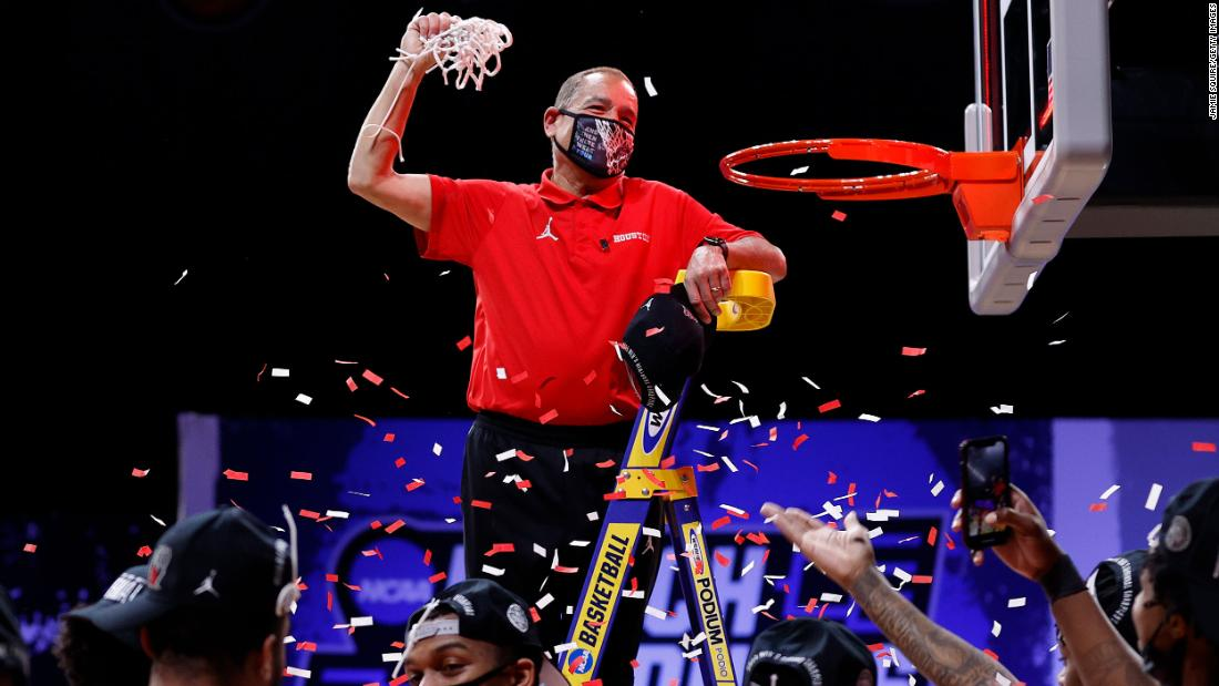 Houston head coach Kelvin Sampson cuts down the net after the Oregon State win.