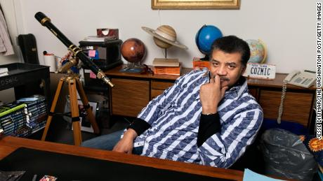 Tyson is shown in his office at the Hayden Planetarium in New York.