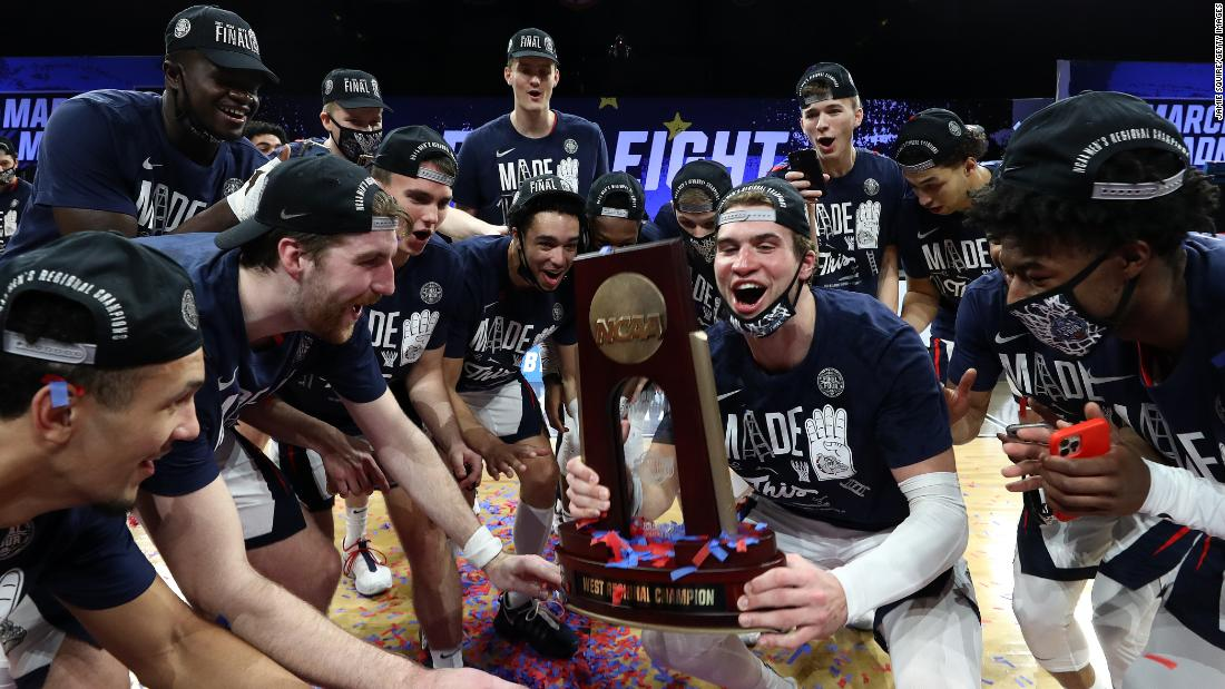 Gonzaga players celebrate after winning the West Regional and clinching a spot in the Final Four. The Bulldogs, the top-seeded team in the tournament, blew out USC 85-66 on Tuesday.