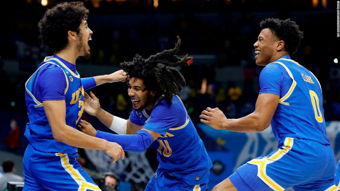 From left, UCLA's Johnny Juzang, Tyger Campbell and Jaylen Clark celebrate on Tuesday after the Bruins defeated Michigan 51-49 to make the Final Four. UCLA, an 11-seed, started in the First Four and then rattled off five straight tournament wins.