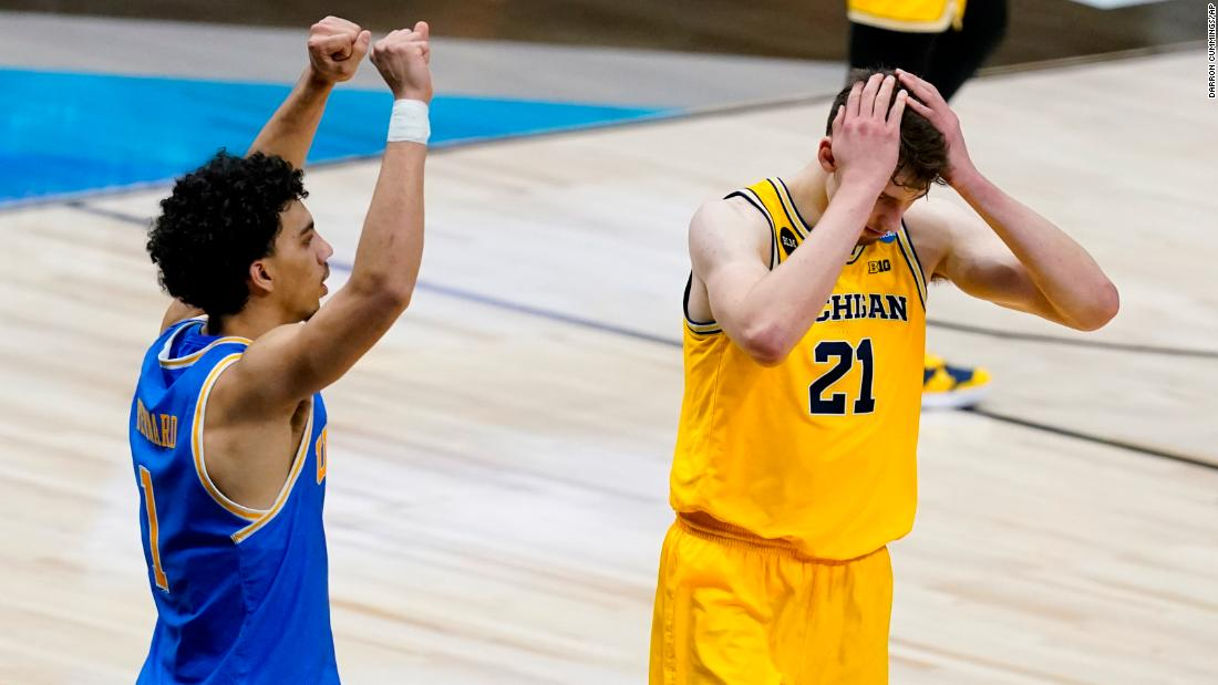 Michigan's Franz Wagner, right, reacts in front of UCLA's Jules Bernard after missing a shot at the end of the game on Tuesday.