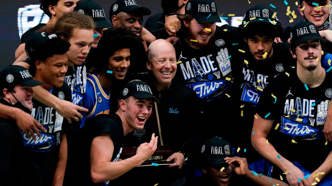 UCLA head coach Mick Cronin celebrates with his team after the Michigan win.