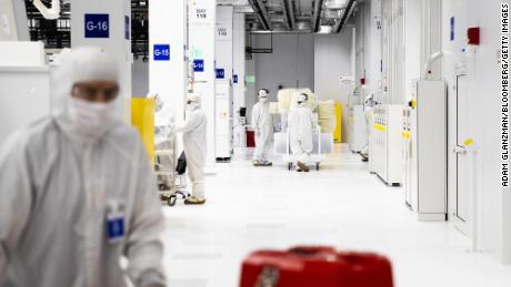 Employees work inside a semiconductor manufacturing facility in Malta, New York, on March 16, 2021. Production plants for semiconductors have become a focal point of economic recovery.