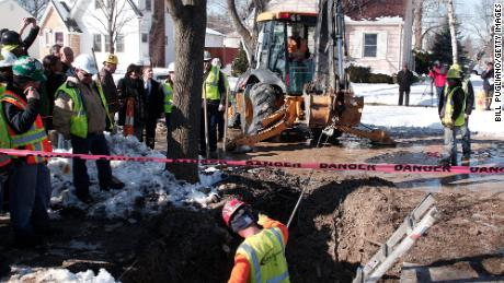 Workers in Flint, Michigan, prepare to replace a lead water service line pipe in 2016. Biden's plan aims to replace all of the nation's lead pipes and services lines.