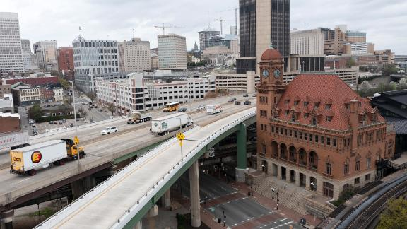 Traffic flows past the Main Street Train Station on the Interstate 95 bridge through downtown Richmond, Va., Wednesday, March 31, 2021.  Looking beyond the $1.9 trillion COVID relief bill, President Joe Biden and lawmakers are laying the groundwork for another of his top legislative priorities — a long-sought boost to the nation's roads, bridges and other infrastructure that could meet GOP resistance to a hefty price tag. (AP Photo/Steve Helber)