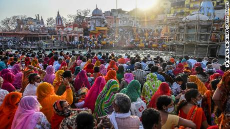 Devotees gather after taking a holy dip in the River Ganges in Haridwar, India, on March 10.
