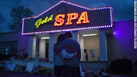 Cynthia Shi and her boyfriend, Graham Bloomsmith, embrace outside Gold Spa near Acworth, Ga., on Thursday, March 18, 2021, one of three massage businesses where eight people were killed and another injured by a shooter on Tuesday. The Atlanta area shootings, in which six women of Asian descent were killed, come amid a tortured public conversation over how to confront a rise in reports of violence against Asian-Americans, who have felt increasingly vulnerable with each new attack. (Chang W. Lee/The New York Times)
