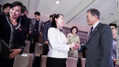 South Korean President Moon Jae-in (right) shakes hands with Kim Yo-Jong (middle), North Korean leader Kim Jong-Un's sister.