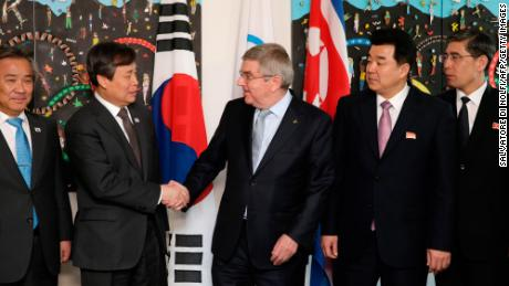 IOC president Thomas Bach (right)  shakes hands with South Korean Sports Minister Do Jong-hwan (second left) next to North Korea's Olympic Committee President and sports minister Kim Il Guk (second right).