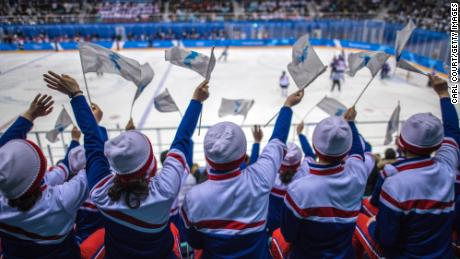 North Korean cheerleaders wave unified Korean flags as they cheer during the Women's Ice Hockey Preliminary Round Group B game between Korea and Japan on day five of the PyeongChang 2018 Winter Olympics.