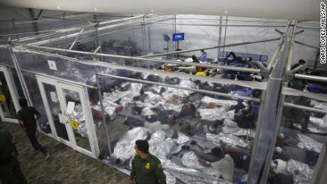 Young minors lie inside a pod at the Donna Department of Homeland Security holding facility, the main detention center for unaccompanied children in the Rio Grande Valley run by U.S. Customs and Border Protection (CBP), in Donna, Texas, Tuesday, March 30, 2021. The minors are housed by the hundreds in eight pods that are about 3,200 square feet in size. Many of the pods had more than 500 children in them. The Biden administration on Tuesday for the first time allowed journalists inside its main detention facility at the border for migrant children, revealing a severely overcrowded tent structure where more than 4,000 kids and families were crammed into pods and the youngest kept in a large play pen with mats on the floor for sleeping.