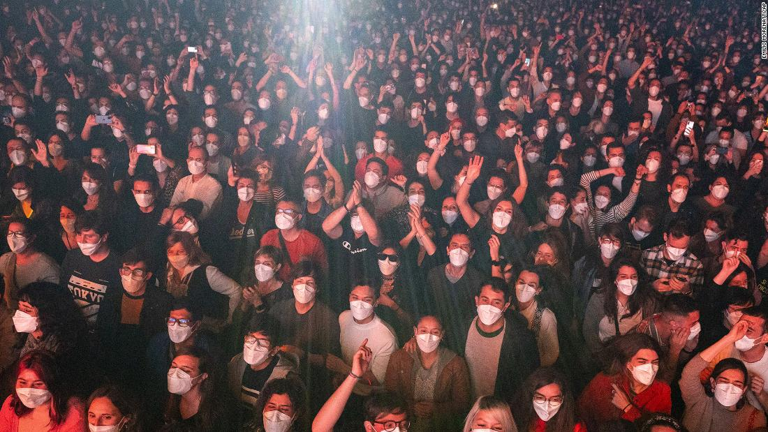 People in Barcelona, Spain, attend a concert for the rock group Love of Lesbian on March 27. Fans had to take a same-day Covid-19 test before attending the show, which was permitted by Spanish health authorities.