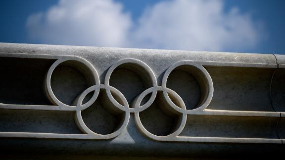 A picture taken on March 8, 2021 in Lausanne shows the Olympic rings next to the headquarters of the International Olympic Committee (IOC) ahead of a session of the World's sport governing body held virtually. (Photo by Fabrice COFFRINI / AFP) (Photo by FABRICE COFFRINI/AFP via Getty Images)
