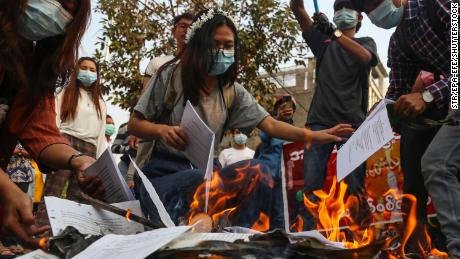 On April 1, demonstrators burned the Myanmar constitution during a military coup protest in Mandalay, Myanmar.