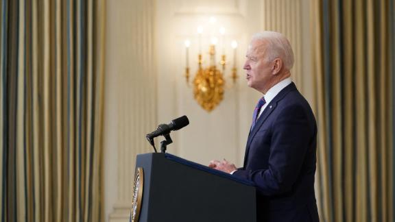 US President Joe Biden speaks about the March jobs report in the State Dining Room of the White House in Washington, DC, on April 2, 2021. - The US economy regained a massive 916,000 jobs in March, the biggest increase since August, with nearly a third of the increase in the hard-hit leisure and hospitality sector, the Labor Department reported on April 2, 2021.