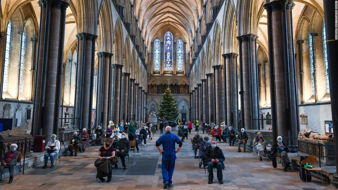 People wait to receive a Covid-19 vaccine January 20 at a vaccination center set up inside Salisbury Cathedral in Salisbury, England.