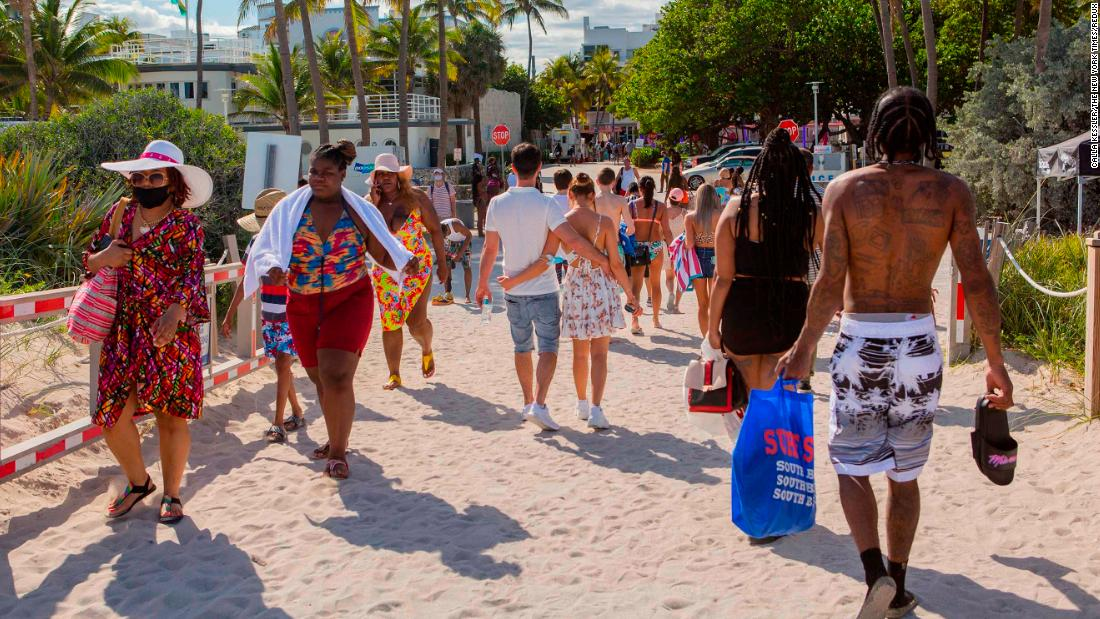"Beachgoers are seen in Miami on March 22.<a href=""https://www.cnn.com/2021/03/22/us/miami-beach-state-of-emergency/index.html"" target=""_blank""> Miami Beach was forced to extend a curfew and state of emergency,</a> possibly for several weeks, after city police struggled to control shoulder-to-shoulder crowds of spring breakers over the weekend, Mayor Dan Gelber said."