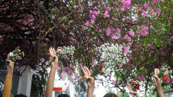 "People take part in a ""flower strike"" in Yangon on April 2."