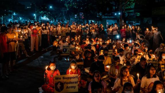 Residents of the Tamwe area of Yangon participate in a candlelight vigil on April 3.