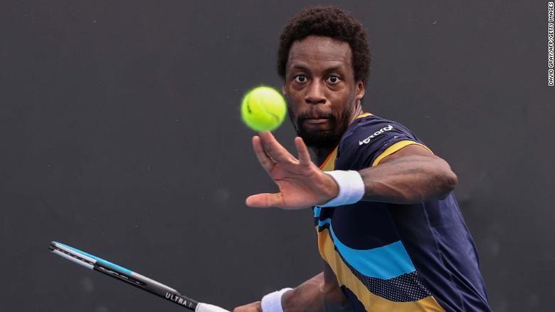 France's Gael Monfils hits a return against Finland's Emil Ruusuvuori during their men's singles match on day one of the Australian Open tennis tournament in Melbourne on February 8, 2021.