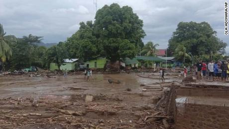 Residents inspecting the destruction of a village during a flash flood in East Flores, Indonesia